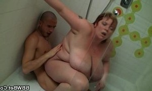 lady  riding on boy  shower  titted mature